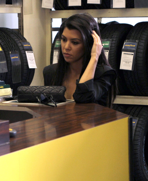 Kourtney Kardashian Kourtney and Kim Kardashian filming their reality show while getting some work done on Kourtney's truck at Just Tires in West Hollywood, CA.