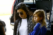 Kourtney Kardashian Spotted With Her Kids At Miami Airport