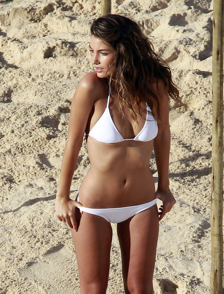 With her slim body and Dark brown hairtype without bra (cup size 31B) on the beach in bikini