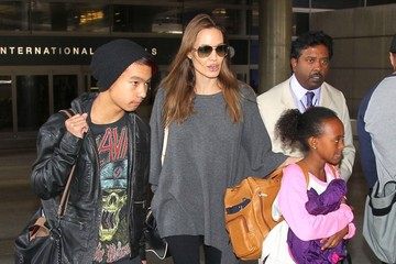 Maddox Jolie-Pitt Angelina Jolie And Kids Arriving On A Flight At LAX