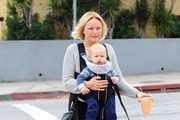 'Trophy Wife' star Malin Akerman grabs a juice while out for a walk with her son Sebastian on March 25, 2014 in Los Feliz, California.