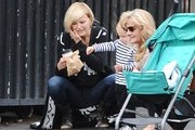 """""""Sin City Saints"""" star Malin Akerman and her son Sebastian feed the pigeons while out on January 29, 2015 in Los Feliz, California. The pair used crumbs from a coffee shop pastry to feed the hungry pigeons, much to the delight of Sebastain."""