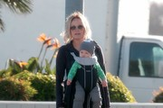 'Trophy Wife' star Malin Akerman takes her son Sebastian for a walk to literally smell the flowers on March 19, 2014 in Los Feliz, California.