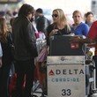 Martin Mica Sharon Stone And Family Departing On A Flight At LAX