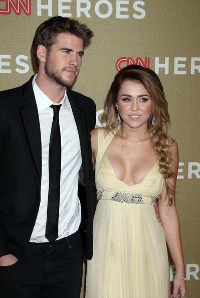 Miley Cyrus Celebrities attend the 2011 CNN Heroes: An All Star Tribute at the Shrine Auditorium in Los Angeles. Pictured: Liam Hemsworth, Miley Cyrus