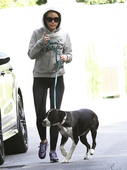 Pop singer Miley Cyrus is spotted walking her dog near her home in Los Angeles, California on November 18, 2014. Miley was enjoying a solo stroll without her new boyfriend, Patrick Schwarzenegger.