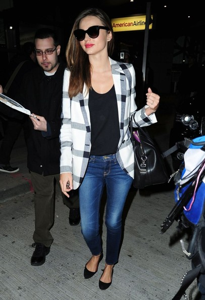 Supermodel Miranda Kerr arriving on a flight at JFK Airport in New York City, New York on February 25, 2013.