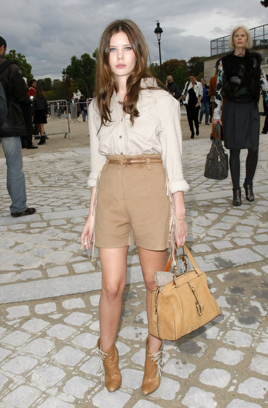 Celebrities arrive at the Chloe fashion show during Paris Fashion Week Spring/Summer 2011.