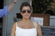 Pregnant reality star Kourtney Kardashian and a friend out shopping and eating at Fred Segal in West Hollywood, California on May 16, 2012