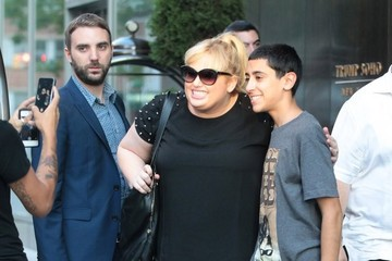 Rebel Wilson Rebel Wilson Poses with a Fan in NYC