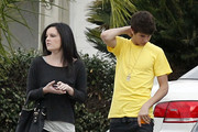 Singer Justin Bieber and girlfriend Selena Gomez seen leaving a friends house after watching the Green Bay Packers NFL game in Sherman Oaks, CA on January 15, 2012. Selena was sporting some blue hair extensions