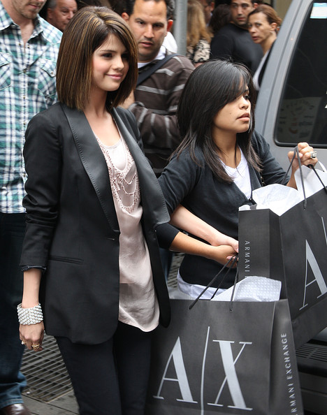 Actress Selena Gomez seen out with a friend after shopping at Armani Exchange in Soho.