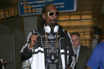 Snoop Dogg Snoop Dogg Arriving On A Flight At LAX