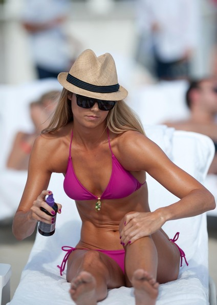Stacy Keibler was seen on the beach in Miami today wearing a hot pink bikini ...