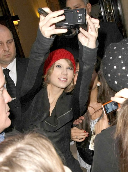 Taylor Swift Singer Taylor Swift is greeted by a bunch of fans as she leaves the Le Meurice Hotel in Paris, France.