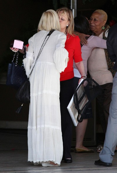 Tori Spelling And Family Leaving The Four Seasons Hotel