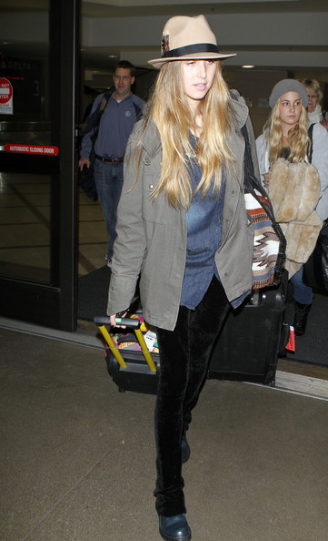 Whitney Port Reality star Whitney Port showing off her smile as she is seen arriving on a flight at LAX airport in Los Angeles, CA.
