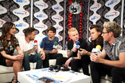 Radio personalities Letty B (L) and JoJo Wright (C) speak with recording artists (from 2nd L) Liam Payne, Louis Tomlinson, Harry Styles and Niall Horan of music group One Direction at 102.7 KIIS FMÂ's Jingle Ball 2015 Presented by Capital One at STAPLES CENTER on December 4, 2015 in Los Angeles, California.