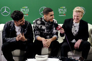 (EDITORIAL USE ONLY. NO COMMERCIAL USE.) JoJo Wright (R) interviews Sergio Calderon and Drew Ramos of In Real Life during 102.7 KIIS FM's Jingle Ball 2019 Presented by Capital One at the Forum on December 6, 2019 in Los Angeles, California.