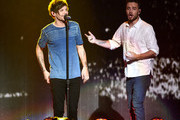 Recording artists Louis Tomlinson (L) and Liam Payne of music group One Direction perform onstage during 102.7 KIIS FMÂ's Jingle Ball 2015 Presented by Capital One at STAPLES CENTER on December 4, 2015 in Los Angeles, California.