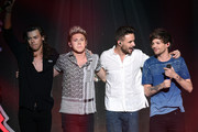 (L-R) Recording artists Harry Styles, Niall Horan, Liam Payne and Louis Tomlinson of One Direction perform onstage during 102.7 KIIS FMÂ's Jingle Ball 2015 Presented by Capital One at STAPLES CENTER on December 4, 2015 in Los Angeles, California.