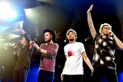 (L-R) Singers Harry Styles, Liam Payne, Louis Tomlinson and Niall Horan of musical group One Direction performs onstage during 106.1 KISS FM's Jingle Ball 2015 presented by Capital One at American Airlines Center on December 1, 2015 in Dallas, Texas.