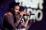 Singers Liam Payne (L) and Louis Tomlinson of One Direction perform onstage during 106.1 KISS FM's Jingle Ball 2015 presented by Capital One at American Airlines Center on December 1, 2015 in Dallas, Texas.