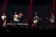 (L-R) Musicians Drew Stewart, Aaron Bruno, Isaac Carpenter, Duff McKagan and Marc Walloch of Awolnation perform onstage during 106.7 KROQ Almost Acoustic Christmas 2015 at The Forum on December 12, 2015 in Los Angeles, California.