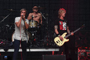(L-R) Musicians Aaron Bruno, Isaac Carpenter and Duff McKagan of Awolnation perform onstage during 106.7 KROQ Almost Acoustic Christmas 2015 at The Forum on December 12, 2015 in Los Angeles, California.