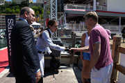 Charlotte Casiraghi shakes hands with Mika Hakkinen as Prince Albert II of Monaco looks on during the special invitational competition of the Longines Global Champions Tour of Monaco on June 25, 2015 in Monaco, Monaco.