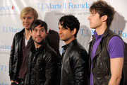 """Musicians Andrew Lee, Michael Bruno, Jason Rosen and Alexander Noyes of the band """"Honor Society"""" pose for a photo backstage at the 11th Annual T.J. Martell Foundation Family Day benefit at Roseland Ballroom on April 18, 2010 in New York City."""