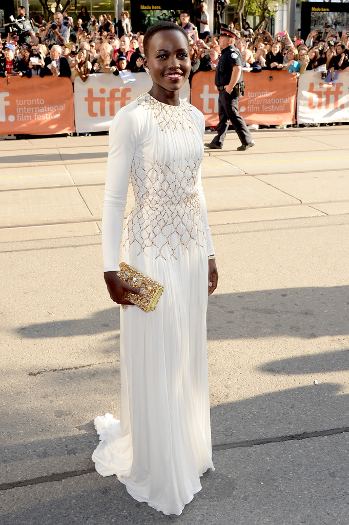 Actress Lupita Nyong'o arrives at the '12 Years A Slave' Premiere during the 2013 Toronto International Film Festival Princess of Wales Theatre on September 6, 2013 in Toronto, Canada.