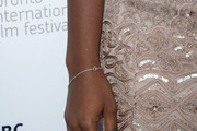 "Actress Adepero Oduye (fashion detail)  arrives at the ""12 Years A Slave"" Premiere during the 2013 Toronto International Film Festival Princess of Wales Theatre on September 6, 2013 in Toronto, Canada."