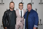 (L-R) Dierks Bentley, Bobby Bones, and Joe Diffie take photos during the 12th Annual ACM Honors at Ryman Auditorium on August 22, 2018 in Nashville, Tennessee.