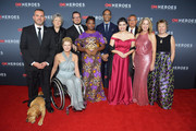 (L-R) 2018 Top 10 CNN Heroes Chris Stout, Florence Phillips, Amanda Boxtel, Luke Mickelson, Abisoye Ajayi-Akinfolarin, Maria Rose Belding, Dr. Ricardo Pun-Chong, Susan Munsey, and Ellen Stackable attend the 12th Annual CNN Heroes: An All-Star Tribute at American Museum of Natural History on December 9, 2018 in New York City.