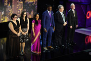 Everyday Heroes Ashley Kurth, Melissa Falkowski, Shanthi Viswanathan, James Shaw, Dr. Jeff Cohen, Rabbi Jeffrey Myers pose onstage during the 12th Annual CNN Heroes: An All-Star Tribute  at American Museum of Natural History on December 9, 2018 in New York City.