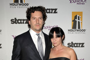 Actress Shannen Doherty (R) and Kurt Iswarienko arrive at the 13th annual Hollywood Awards Gala Ceremony held at The Beverly Hilton Hotel on October 26, 2009 in Beverly Hills, California.
