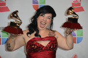 Singer Carla Morrison poses with the awards for Best Alternative Music Album and Best Alternative Song in the press room during the 13th annual Latin GRAMMY Awards held at the Mandalay Bay Events Center  on November 15, 2012 in Las Vegas, Nevada.