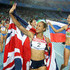 Jessica Ennis Photos - Jessica Ennis of Great Britain celebrates with her country's flag after competing in the 800 metres and claiming silver in the women's heptathlon during day four of the 13th IAAF World Athletics Championships at the Daegu Stadium on August 30, 2011 in Daegu, South Korea. - 13th IAAF World Athletics Championships Daegu 2011 - Day Four