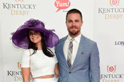 Cassandra Jean (L) and actor Stephen Amell attend the 142nd Kentucky Derby at Churchill Downs on May 07, 2016 in Louisville, Kentucky.