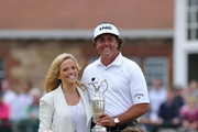 Phil Mickelson of the United States holds the Claret Jug wife Amy and children Evan, Amanda and Sophia after winning the 142nd Open Championship at Muirfield on July 21, 2013 in Gullane, Scotland.