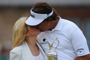 Phil Mickelson of the United States kisses wife Amy after winning the 142nd Open Championship at Muirfield on July 21, 2013 in Gullane, Scotland.