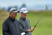 Justin Rose of England looks on with caddie Mark Fulcher during a practice round prior to the start of The 143rd Open Championship at Royal Liverpool on July 16, 2014 in Hoylake, England.