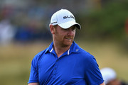 John Singleton of England walks across a green during a practice round prior to the start of The 143rd Open Championship at Royal Liverpool on July 16, 2014 in Hoylake, England.