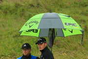 Justin Rose of England looks on the 11th hole with his caddie during a practice round prior to the 148th Open Championship held on the Dunluce Links at Royal Portrush Golf Club on July 17, 2019 in Portrush, United Kingdom.