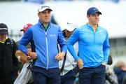 Justin Thomas of the United States and Rory McIlroy of Northern Ireland walk down the 2nd hole during a practice round prior to the 148th Open Championship held on the Dunluce Links at Royal Portrush Golf Club on July 17, 2019 in Portrush, United Kingdom.