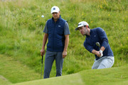 Jordan Spieth of the United States and Patrick Cantlay of the United States play a shot during a practice round prior to the 148th Open Championship held on the Dunluce Links at Royal Portrush Golf Club on July 16, 2019 in Portrush, United Kingdom.
