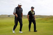 Tiger Woods of the United States and putting coach Matt Killen walk during a practice round prior to the 148th Open Championship held on the Dunluce Links at Royal Portrush Golf Club on July 16, 2019 in Portrush, United Kingdom.