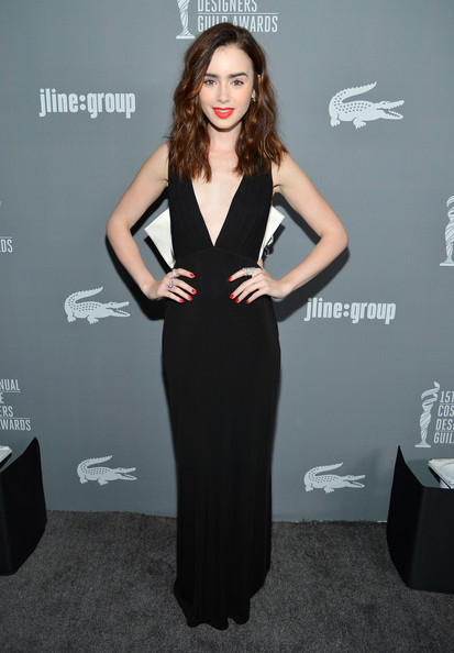 Presenter Lily Collins attends the 15th Annual Costume Designers Guild Awards with presenting sponsor Lacoste at The Beverly Hilton Hotel on February 19, 2013 in Beverly Hills, California.