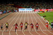 (L-R) Andre De Grasse of Canada, Asafa Powell of Jamaica, Justin Gatlin of the United States, Tyson Gay of the United States, Usain Bolt of Jamaica, Mike Rodgers of the United States, Trayvon Bromell of the United States, Bingtian Su of China and Jimmy Vicaut of France cross the finish line in the Men's 100 metres final during day two of the 15th IAAF World Athletics Championships Beijing 2015 at Beijing National Stadium on August 23, 2015 in Beijing, China.